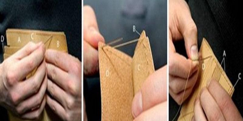 Khẩu ví với đường chỉ màu xanh lá cây và màu vàng